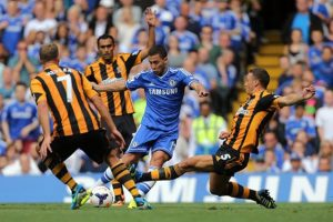 Hull City's James Chester (right) and Chelsea's Eden Hazard battle for the ball